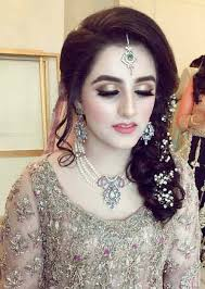 enement makeup look with grey dress