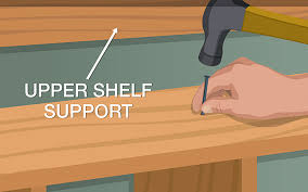 this picture shows you how to place and secure the long shelves of your diy closet