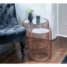copper side table with a glass top nest table