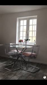 round glass dining table and 4 tobias chairs