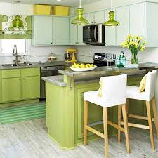 white walls and green kitchen cabinets