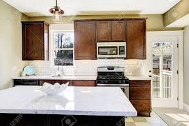 Top Kitchen Kitchen Room With Steel Appliances White Tile Back Splash Trim