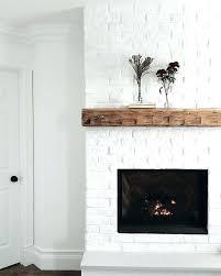 wood mantel on white brick fireplace white brick fireplace mantle red wood mantle on white brick