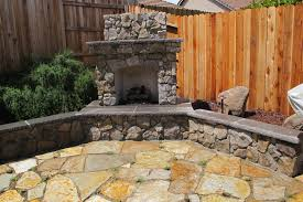 exterior design ingenious corner backyard fireplace design with marble patio flooring and green bushes and