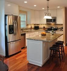 kitchen remodel white cabinets tile backsplash undercabinet lighting island traditional kitchen