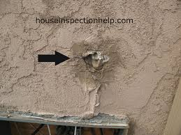fix hole in exterior wall stucco a
