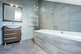 a small bathroom made to feel larger with good use of tiles