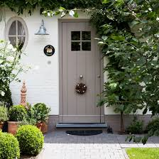 front garden with flowers and path leading to grey front door