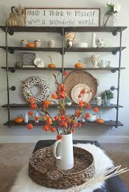 DIY industrial pipe shelves with farmhouse orange-autumn decor