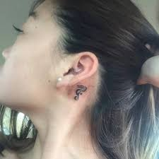 Behind The Ear Tattoo Of A Seahorse On Irene