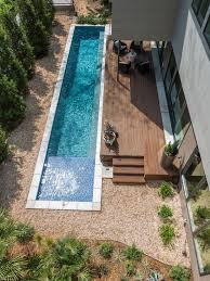 backyard swimming pool designs. Narrow Backyard Pool Clad With White Tiles Next To A Wooden Deck Swimming Designs