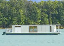 this metroship luxury houseboat by ballinger co is being offered as one of this