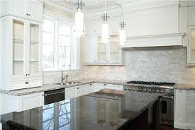 backsplash with white cabinets white tile with white kitchen cabinets white cabinets black countertop blue backsplash