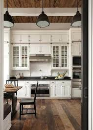 kitchens with high ceilings glass cabinets with solid cabinet doors on top love the floors kitchen cabinets 14 foot high ceilings