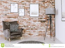 red brick furniture. Contemporary Red Patterned Pillow On Grey Armchair And Lamp Against Red Brick Wall With  Posters In Living Room Interior To Red Brick Furniture
