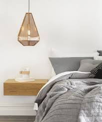 copper lighting fixture over the night stand