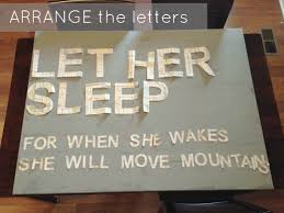 mod podge the letters onto the canvas this is where the ruler or yard stick comes in handy to keep the letters straight i used the mod podge to glue down  on wall art stencils letters with diy nursery art let her sleep snappy casual