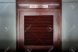 American Fire Hose And Cabinet Wooden Door Of Fire Hose Reel Cabinet Stock Photo Picture And