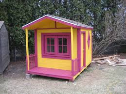 a yellow and pink wooden playhouse instructables this free playhouse plan