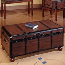 block brown trunk table with storage combined with black leather straps plus round brown wooden legs