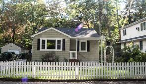 white picket fence. House With Sunspots And White Picket Fence A