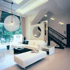 black and white living room design with modern woven pendant lamp and using extra high ceiling ideas