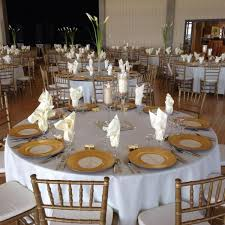 fine china linens stemware and flatware with gold chiavari chairs at sanders beach