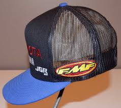 yamaha hat. this is a jgr toyota yamaha fmf pirelli mesh team hat. it was never worn but marked with pin under the bill in small letters (see photos) hat k