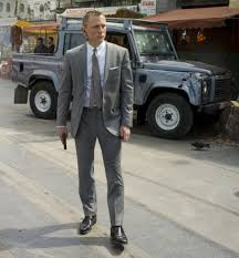 James Bond (Daniel Craig) In Front Of The Land Rover Defender Double Cab,  A Promotional Photo For SkyFall