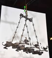 this antique rectangular french iron chandelier has a myriad of interesting hand forged shapes made