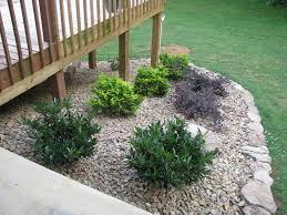 landscaping around a deck | LightsOnTheLake: Rock Garden around deck-Done!