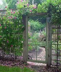 old screen door as garden gate love this