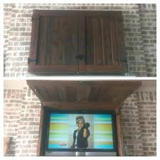 how to build an outdoor tv enclosure outdoor cabinet built on over fireplace mantle and a
