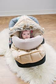 the soft faux fur hood creates a cozy co for baby or zips fully open to lay flat the water repellent shell protects children from rain snow and wind