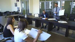 wide angle view busy design office. two businesswomen and businessmen discussing contract in meeting room 4k stock video clip wide angle view busy design office i