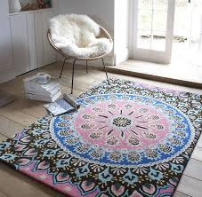 nomadic pink and blue patterned rug