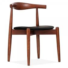 brown elbow chair with round seat