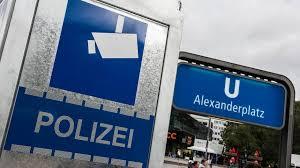 Alexanderplatz is one of the busiest thoroughfares in berlin. Alexanderplatz Mann Eine S Bahn Treppe Hinuntergestossen