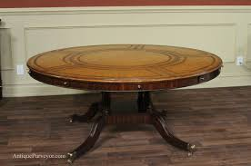maitland smith large round leather top perimeter table with leaves