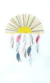 sun and feather wall hanging juju nz decor feather wall hanging
