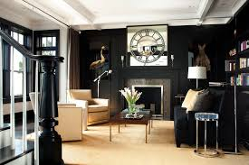 black accent wall living room transitional with wall paneling wall art
