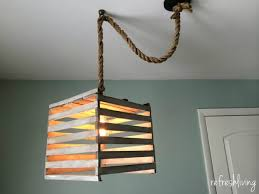 farmhouse style light fixture made from an antique egg crate it s easy to make using