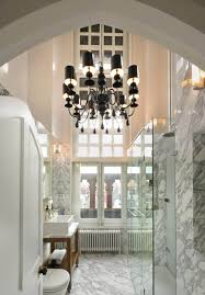 elegant black bathroom chandeliers with marble gray wall also mirrored cabinet and towel rack