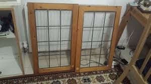 kitchen cupboard with wood glass doors