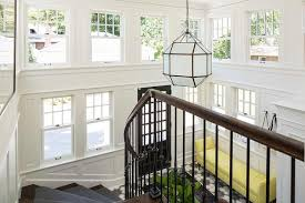2 story foyer with yellow bench view full size