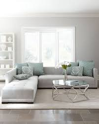 minimalist interior in dove grey with patterned green textiles