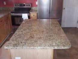 charlotte nc granite countertop installed giallo ornamental medium wood cabinets 40 60 sink 2 4 12