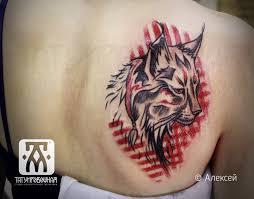 татуировка на лопатке у девушки рысь фото рисунки эскизы
