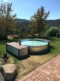 stock tank pool with curved bench for dipping feet used tanks water trough used stock tanks