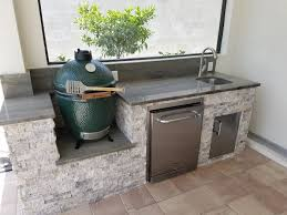 silver travertine stacked stone silver travertine stacked stone custom outdoor kitchen with built in big green egg grill